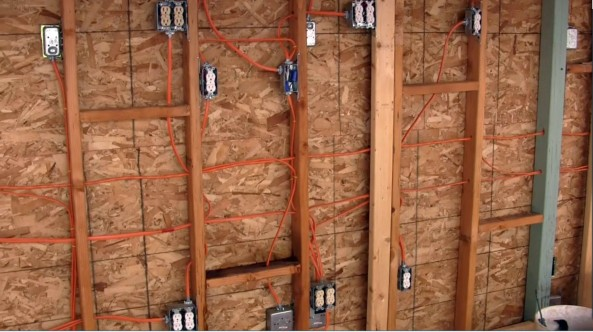 Here's what the inside wall of the Fishroom looks like after we tore off the siding and wired it for our new system.
