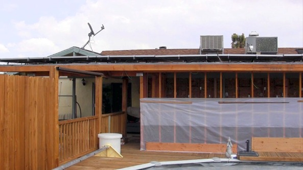 There's a breezeway between the roof and the panels that is about four inches in height.